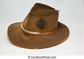 Old, worn brown hat, that is stained with sweet of hard...