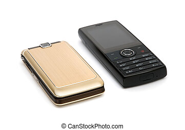 Cell phones - Two cellular telephones are photographed...