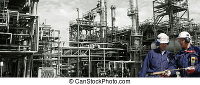 engineers and chemical industry - two engineers, with large...