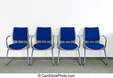 Ordinary waiting room - Four Blue chairs in simple empty...
