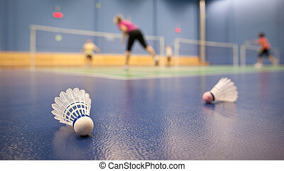 badminton courts with players competing - badminton -...