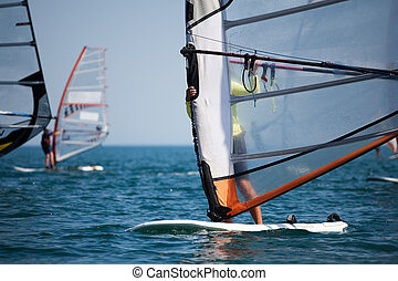 Surfing - Unrecognizable sportsman on windsurfing in the sea