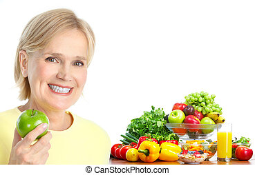 woman with apple - Mature smiling woman with apple, fruits...