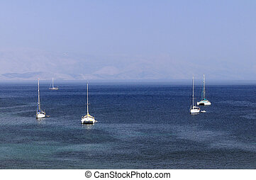 Sailboats at anchor on the sea
