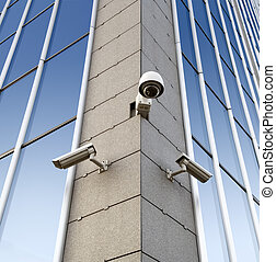 Security cameras on the wall - Three security cameras...