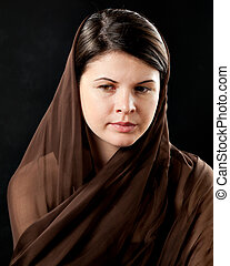 Woman wearing scarf on black - 20 year old woman wearing a...