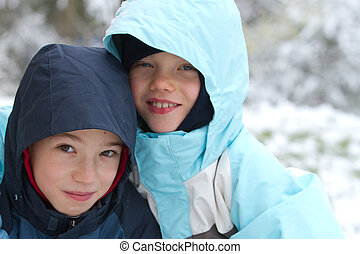 Two smiling children in winter