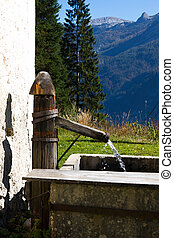 Water source at mountain hiking trail, Hallstatt in Austria
