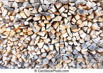 Chipped fire wood - heap of firewoods as background Close -...
