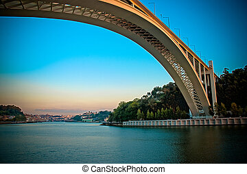 Oporto bridge at beautiful sunset.