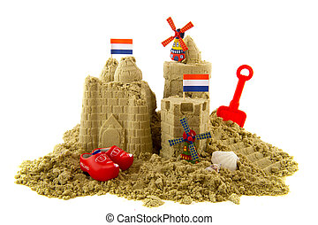 Sandcastle at the Dutch beach isolated over white