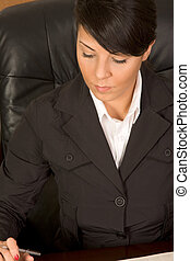 Executive assistant woman in business suit writing -...
