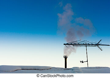 Smoking chimney in winter - Smoking chimney of family home...