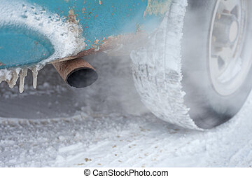 Vehicle exhaust pipe in winter - Exhaust pipe of idling car...