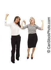Business Woman - two business women with arms aloft as...
