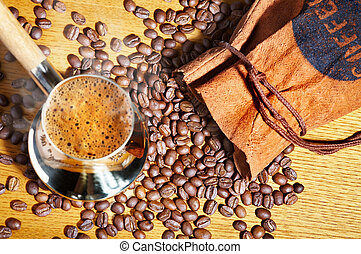 Turkish coffee pot and coffee beans