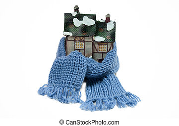 Winter toy house wraped in a shawl