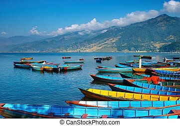 Beautiful lake - Colorful boats on Fewa lake, Pokhara, Nepal...