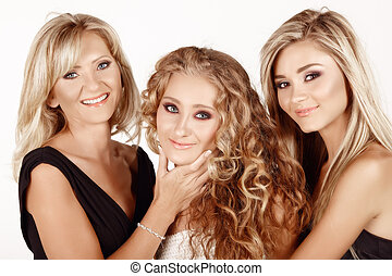 mother and two daughters. - two generations of women: mother...