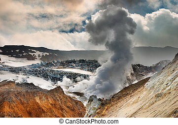 Active volcano - People inside active volcanic crater,...