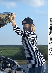 Young Blond Woman With Her Broken Car - young blond woman...