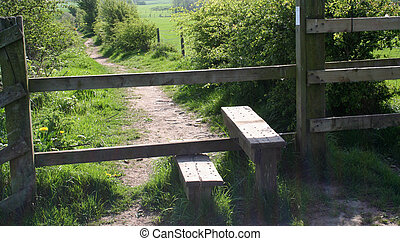 Inviting stile in country side setting