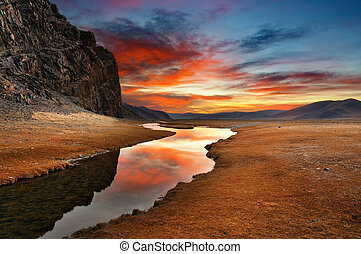 Daybreak in mongolian desert - Colorful sunrise in mongolian...