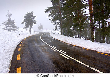 Snowy road - Snowy landscape of a mountain road with yellow...