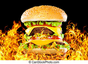 Tasty hamburger on fire on a dark
