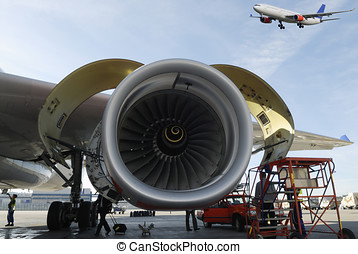 airplane and jet engines - airliner being serviced, jet...
