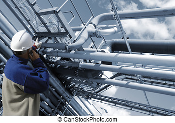 pipelines and engineering - engineer pointing at oil and...