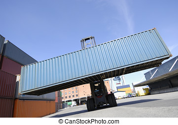 forklift hoisting large container - forklift and freight...