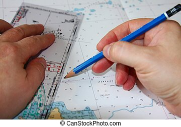 Planning a trip - A Man's Hand Plotting a Route on a...