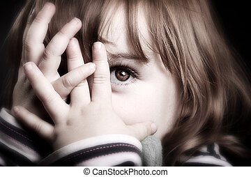 Peekaboo! - A gorgeous little girl playing peekaboo and...