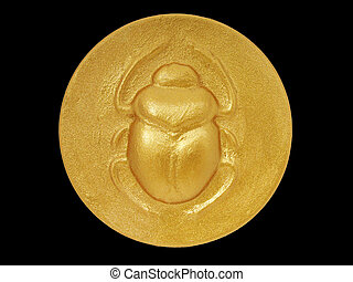 Scarab - golden color egyptian amulet with image of scarab...