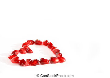 Pomegranate heart - Heart made of pomegranate seeds isolated...