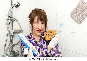 woman serial cleaner - funny woman holding brushes ready to...