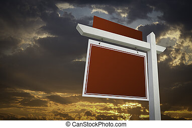 Blank Red Real Estate Sign Over Sunset Sky