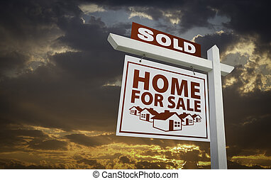 White Sold Home For Sale Real Estate Sign Over Sunset Sky -...