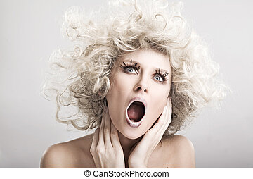 Beautiful blond woman screaming