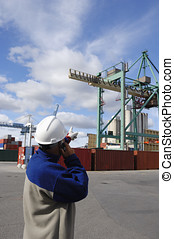worker directing container crane - port worker in hard-hat...