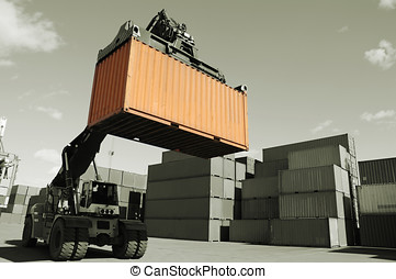forklift hoisting freight container - large forklift,...