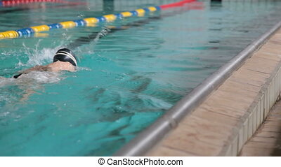 Young Swimmer - child competing in a swimming race