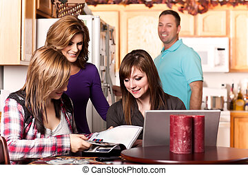 Family at home - A shot of a caucasian family spending time...