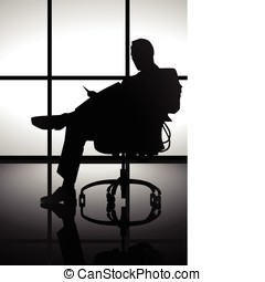 Businessman - Stock image of a man silhouette sitting on a...