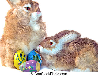 Pair Of Hares - Easter bunnies with colored eggs isolated on...