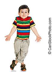 Little boy shrugging shoulders against white background