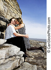kissing couple - happy couple celebrating their engagement...
