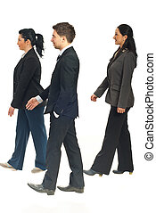 Profile of business people walking - Profile of three...