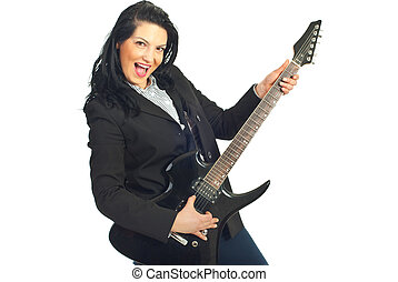 Cheerful busineswoman with guitar - Cheerful businesswoman...